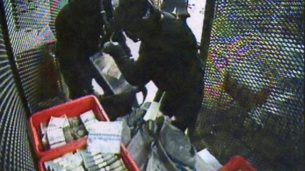 This CCTV image of Sept. 23, 2009 made available by Swedish Police July 19, 2010 shows two of several robbers inside the G4S cash depot in Stockholm, Sweden. (AP / Swedish Police)