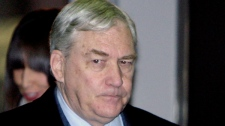 In this Dec. 10, 2007 file photo, convicted newspaper mogul Conrad Black arrives at the federal building in Chicago for sentencing in his racketeering and fraud trial. The Supreme Court has agreed to hear the case of Black, who was sent to prison under the so-called honest-services fraud law. The law is now under attack as vague and unfair in two separate cases before the U.S. Supreme Court. (AP/ M. Spencer Green, File)