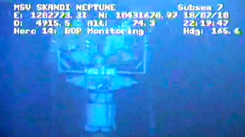 In this image taken from video provided by BP PLC at 22:19 CDT, the containment stack is shown at the site of the Deepwater Horizon oil spill in the Gulf of Mexico Sunday, July 18, 2010. (AP /BP PLC)