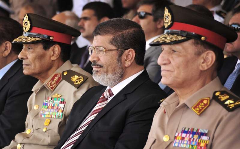 Egyptian Field Marshal Gen. Hussein Tantawi, left, and President Mohammed Morsi, centre, attend a medal ceremony, at a military base east of Cairo, Egypt, on Thursday, July 5, 2012. (AP  / Mohammed Abd El Moaty, Egyptian Presidency)