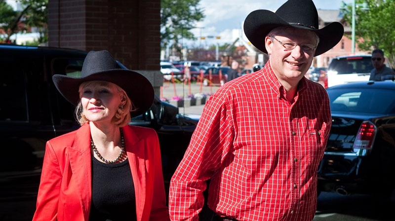 Prime Minister Stephen Harper and his wife Laureen arrive for the Calgary Stampede president's dinner in Calgary, Friday, July 6, 2012. (Jeff McIntosh / THE CANADIAN PRESS)
