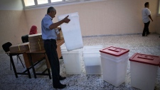 A Libyan election official works at a polling station in Tripoli, Libya, Friday, July 6, 2012.