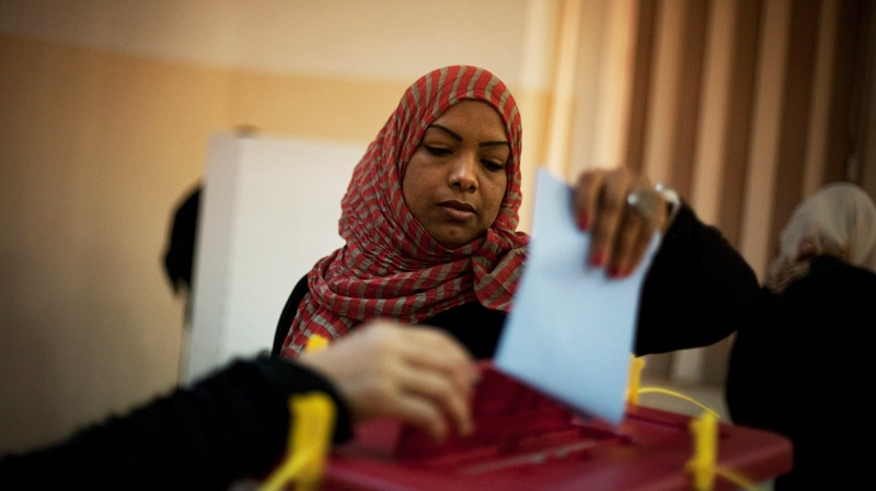 A Libyan woman votes at a polling station in the old city of Tripoli, Libya on Saturday, July 7, 2012.  (AP / Manu Brabo)