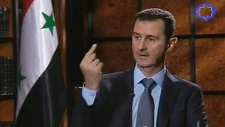 Syria's president Bashar Assad speaks during an interview in Tehran, Iran, Thursday, June 28, 2012