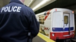 A member of the Greater Vancouver Transit Authority Police Service watches a SkyTrain leave the station in Vancouver, Monday, Dec. 5, 2005. (Richard Lam / THE CANADIAN PRESS)
