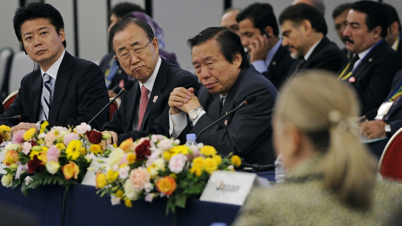UN Secretary-General Ban Ki-moon, second left, and Japanese Foreign Minister Koichiro Gemba, left, watch U.S. Secretary of State Hillary Rodham Clinton, foreground, deliver a speech during the Tokyo Conference on Afghanistan in Tokyo Sunday, July 8, 2012. (AP / Franck Robichon, Pool)