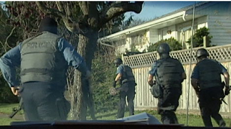 Police raid a suspected Hells Angels home in this file footage from the 1990s. (CTV)