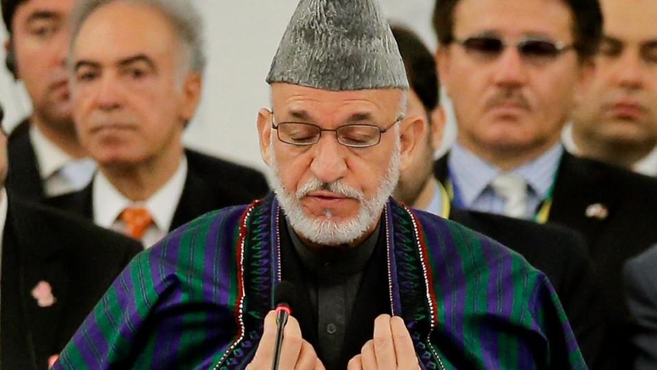 Afghan President Hamid Karzai delivers his speech during the opening session of an international conference on Afghan civilian assistance, at a hotel in Tokyo on Sunday, July 8, 2012. (AP / Itsuo Inouye)