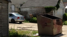 Emergency services pulled a seriously injured man from this dumpster Saturday morning.