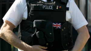 A police officer keeps watch in Westminster near the London 2012 beach volleyball venue, in London, Wednesday, March 28, 2012. (AP / Kirsty Wigglesworth)