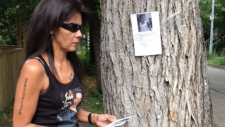 Dolly Felix posters the neighbourhood where her nephew Johnathen Felix was found dead in March.