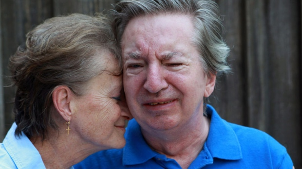 Deb Mulligan visits with her husband Brian Mulligan in London, Ont., July 6, 2012.