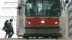 A TTC streetcar picks up passengers in Toronto. (The Canadian Press/J.P. Moczulski)