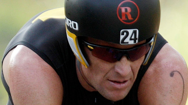 Lance Armstrong competes in the Ironman Panama 70.3. triathlon in Panama City, Panama, Sunday, Feb. 12, 2012. (AP / Arnulfo Franco)
