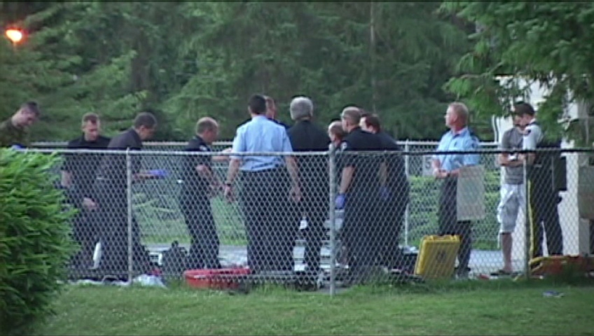 Emergency officials at the scene of a drowning in Surrey, B.C.
