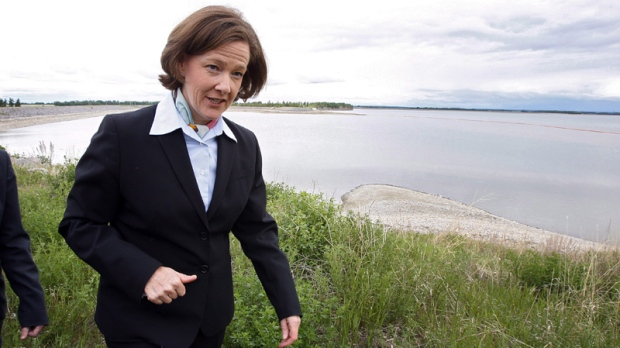Alberta Premier Alison Redford walks past Gleniffer reservoir near Sundre, Alta., on June 8, 2012.
