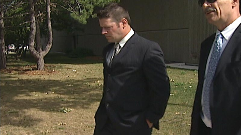 WRPS Const. Andrew Robson is seen outside the courthouse in Kitchener, Ont. on Monday, July 9, 2012.