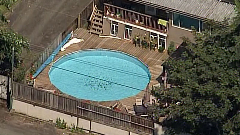 A two-year-old girl was rushed to hospital after she was pulled from this backyard pool in the 9600-block of 129 Street in Surrey. July 9, 2012. (CTV)