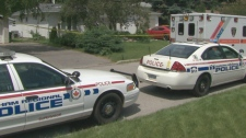 Durham Police and ambulances outside the Vistula Drive residence in Pickering where the incident took place on Thursday, July 22, 2010.