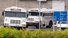 Public Security buses wait outside the prison at the Orsainville detention centre in Quebec City on Thursday, July 22, 2010. (Jacques Boissinot / THE CANADIAN PRESS)