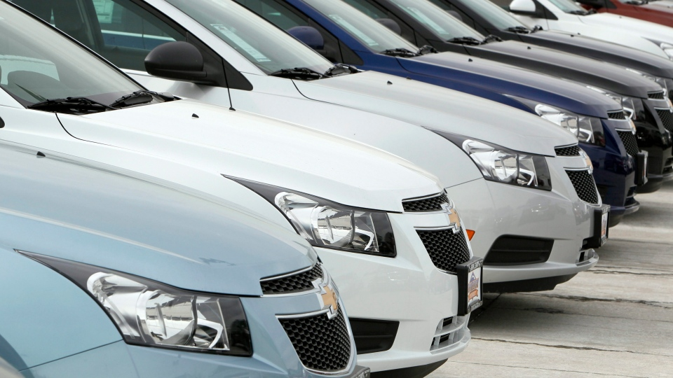 In this Feb. 19, 2012 file photo, a line of 2012 Chevrolet Cruze sedans sit at a dealership in the south Denver suburb of Englewood, Colo. (AP / David Zulubowski)