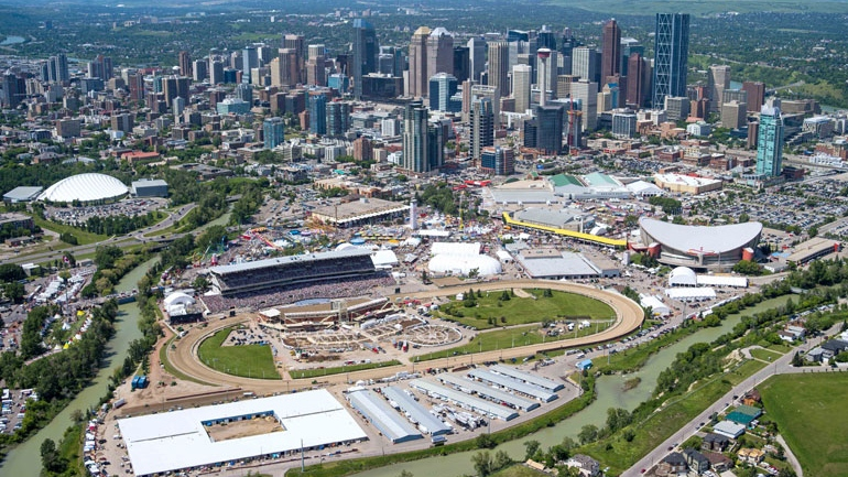 The grounds of the Calgary Stampede are shown in this aerial photo with the city of Calgary, Alta., in the background on Saturday, July 7, 2012. (Calgary Stampede / Chris Bolin)