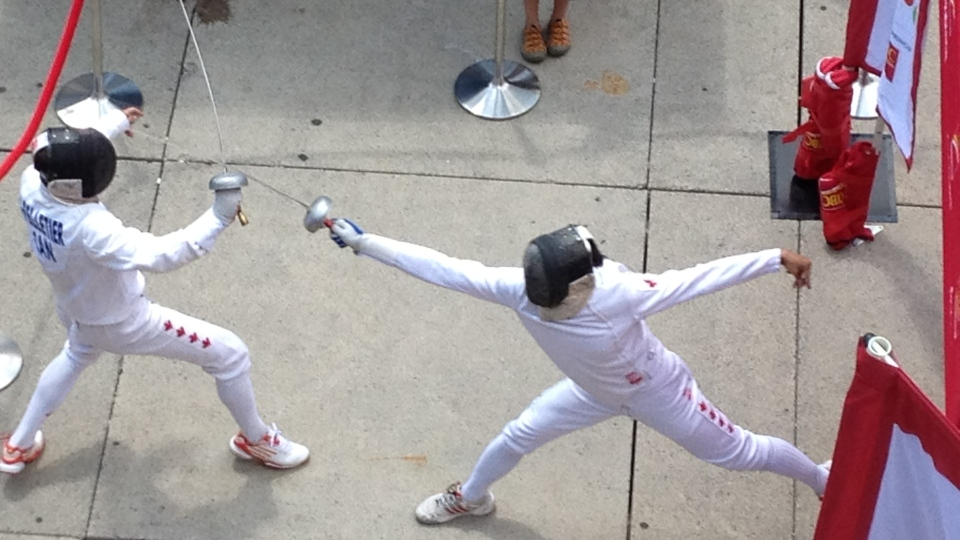 Fencers perform at an event to mark the three-year countdown to Toronto's 2015 Pan Am Games. (Peter Leclair/CTV Toronto)