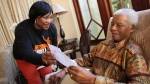 Former South African president Nelson Mandela sits with his youngest daughter Zindzi, a day before his 92nd birthday, at his home in Johannesburg on  Saturday, July 17, 2010. (AP / Debbie Yazbek, Nelson Mandela Foundation)