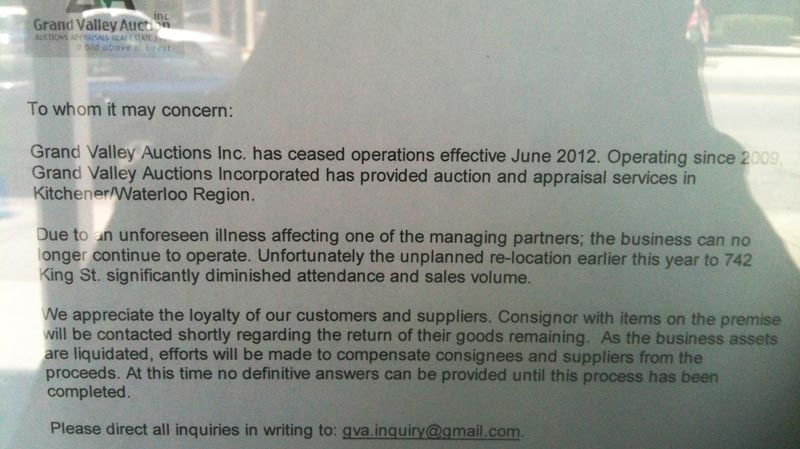 A letter is seen posted on the front door of the offices of Grand Valley Auctions in Cambridge, Ont. on Tuesday, July 10, 2012.