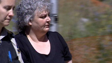 Kimberly Noyes is escorted into a courtroom in Rossland, B.C., before the verdict is announced in her second-degree murder trial. July 23, 2010. (CTV)