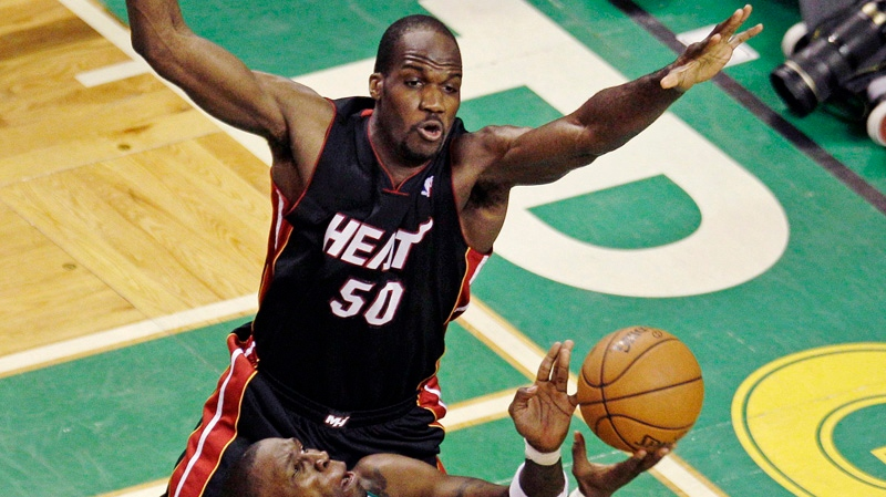 Miami Heat center Joel Anthony (50) defends over Boston Celtics forward Mickael Pietrus while trying for the block during the third quarter of Game 4 in their NBA basketball Eastern Conference finals playoffs series in Boston, Sunday, June 3, 2012. (AP Photo/Charles Krupa)