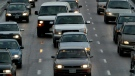 Commuters sit in rush hour traffic on the Don Valley Parkway in Toronto Monday, February 10, 2003. (CP PHOTO/Kevin Frayer)