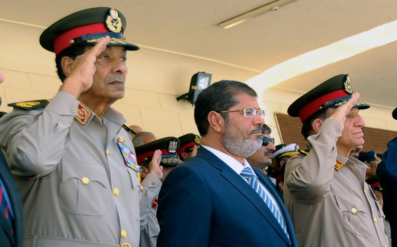 Egyptian Field Marshal Hussein Tantawi, left, President Mohammed Morsi, centre, and Chief of Staff Sami Anan, right, attend a ceremony at an Air Force base in Cairo, Egypt, Tuesday, July 10, 2012. (AP / Fady Fares, Egyptian Presidency)