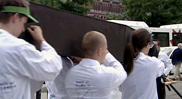 Canadian scientists hold a mock funeral to protest research budget cuts, Tuesday, July 10, 2012.
