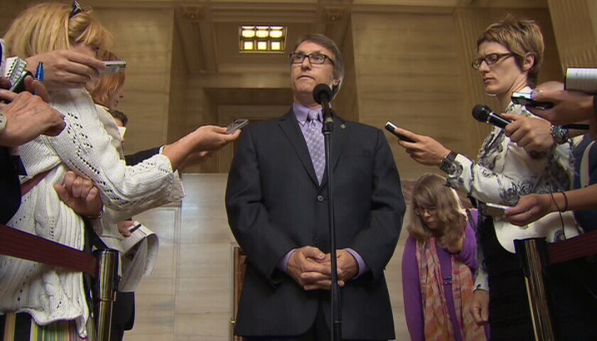 Conservative MP Ted Opitz speaks to the media following a decision from the Supreme Court of Canada, Tuesday, July 10, 2012.