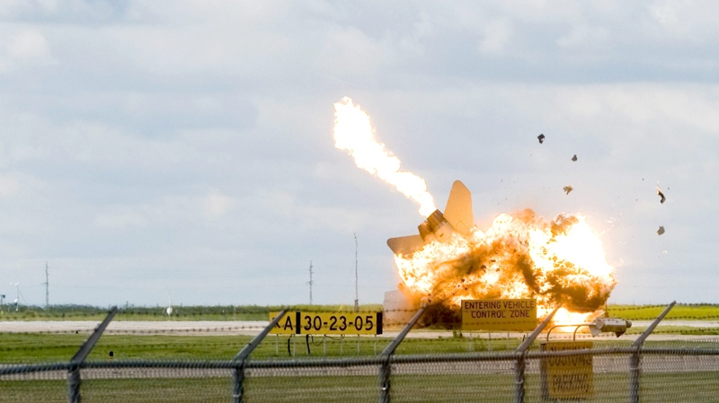 A CF-18 fighter jet crashes during a practice flight for this weekend's Alberta International AirShowi n Lethbridge, Alta., at the Lethbridge County Airport on Friday, July 23, 2010. (Lethbridge Herald - Ian Martens / THE CANADIAN PRESS)