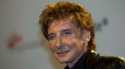 Singer Barry Manilow arrives at an awards ceremony in Berlin, Thursday, March 22, 2012. (AP Photo/Markus Schreiber)