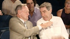 Former prime minister Jean Chretien makes a gesture like the 'Shawinigan handshake' as he jokes with Liberal Leader Michael Ignatieff in Shawinigan, Que. on Thursday, July 22, 2010.