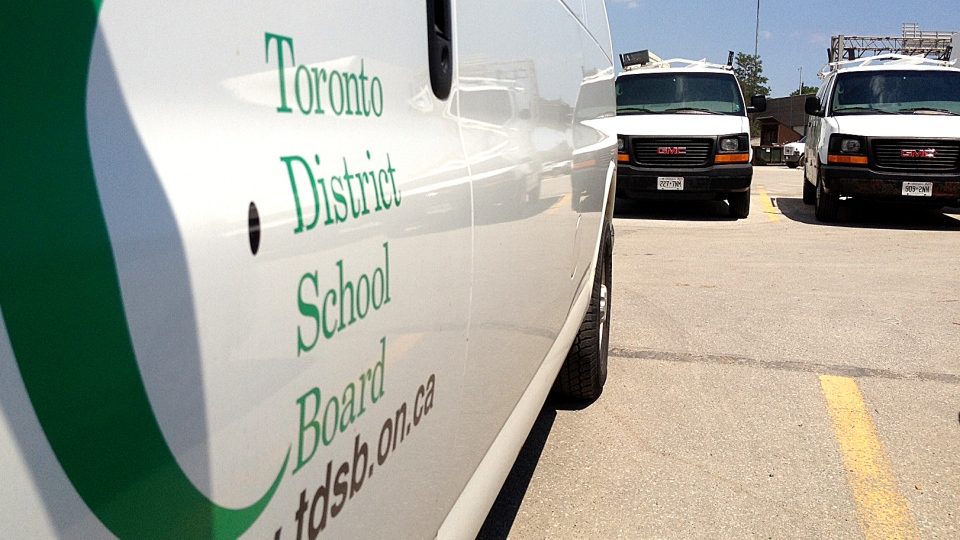 TDSB service vans and trucks sit idle in a parking lot on Wednesday, July 11, 2012. (Corey Baird/CTV Toronto)
