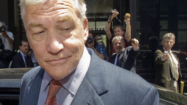 Conrad Black leaves after his bail hearing at U.S. federal court in Chicago, Friday, July 23, 2010. (Ryan Remiorz / THE CANADIAN PRESS)