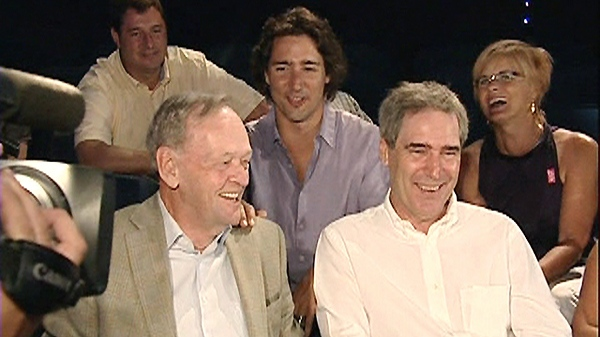 Former prime minister Jean Chretien laughs after demonstrating the 'Shawinigan handshake' on Liberal MP Justin Trudeau, center, as Liberal Leader Michael Ignatieff looks on in Shawinigan, Que., Thursday, July 22, 2010.