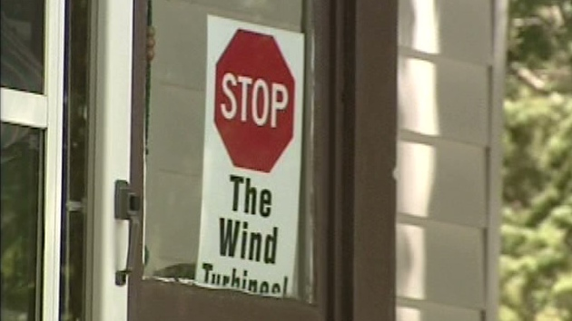 A sign opposing wind turbines is seen in the Belwood area on Wednesday, July 11, 2012.