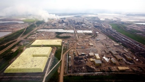 The Syncrude oilsands facility seen from a helicopter near Fort McMurray, Alta., Tuesday, July 10, 2012.  (Jeff McIntosh /  THE CANADIAN PRESS)