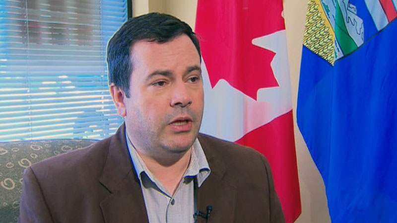 Immigration Minister Jason Kenney explains a rise in U.S. immigration in Canada on July 11, 2012.
