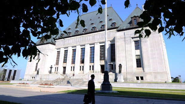 A pedestrian walks past the Supreme Court of Canada in Ottawa. (Sean Kilpatrick / THE CANADIAN PRESS)