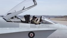 Capt. Brian Bews from 425 Tactical Fighter Squadron based at 3 Wing in Bagotville, Que. is shown sitting in the cockpit of his CF-18 Hornet. (Canadian Armed Forces-Cpl. Alex Roy / THE CANADIAN PRESS)