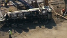 A dump truck is seen on its side after an industrial accident in Markham, Ont., on Thursday, July 12, 2012.