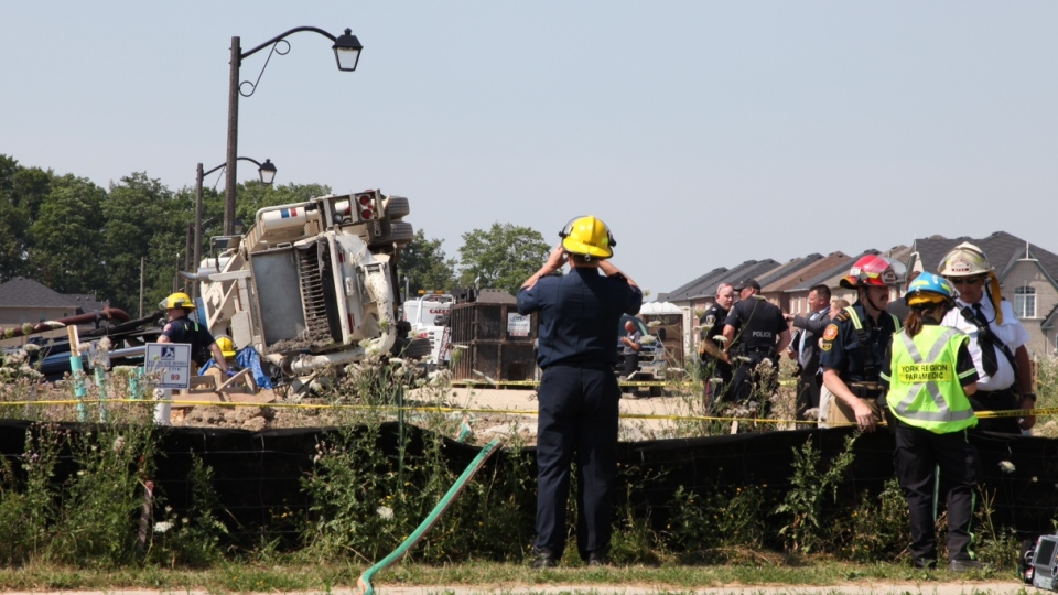 Emergency crews at the scene of an industrial accident in Markham where one man was killed when he was crushed by a flipped truck on Thursday, July 12, 2012. (CTV Toronto/Tom Podolec)