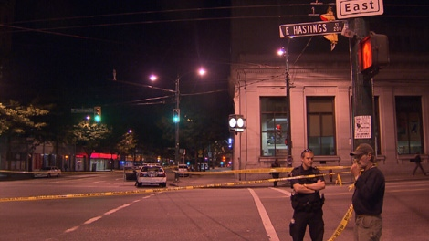 The scene of a stabbing at the intersection of Main and Hastings streets is cordoned off early Sunday morning. July 25, 2010. (CTV)