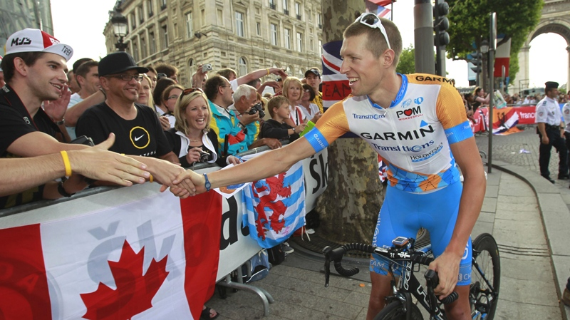Ryder Hesjedal  of Canada greets fans during the parade after the 20th and last stage of the Tour de France cycling race over 102.5 kilometers (63.7 miles) with start in Longjumeau and finish in Paris, France, Sunday, July 25, 2010. (AP / Bas Czerwinski)